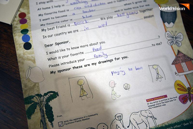 후원아동 필립이 직접 작성한 편지와 그림